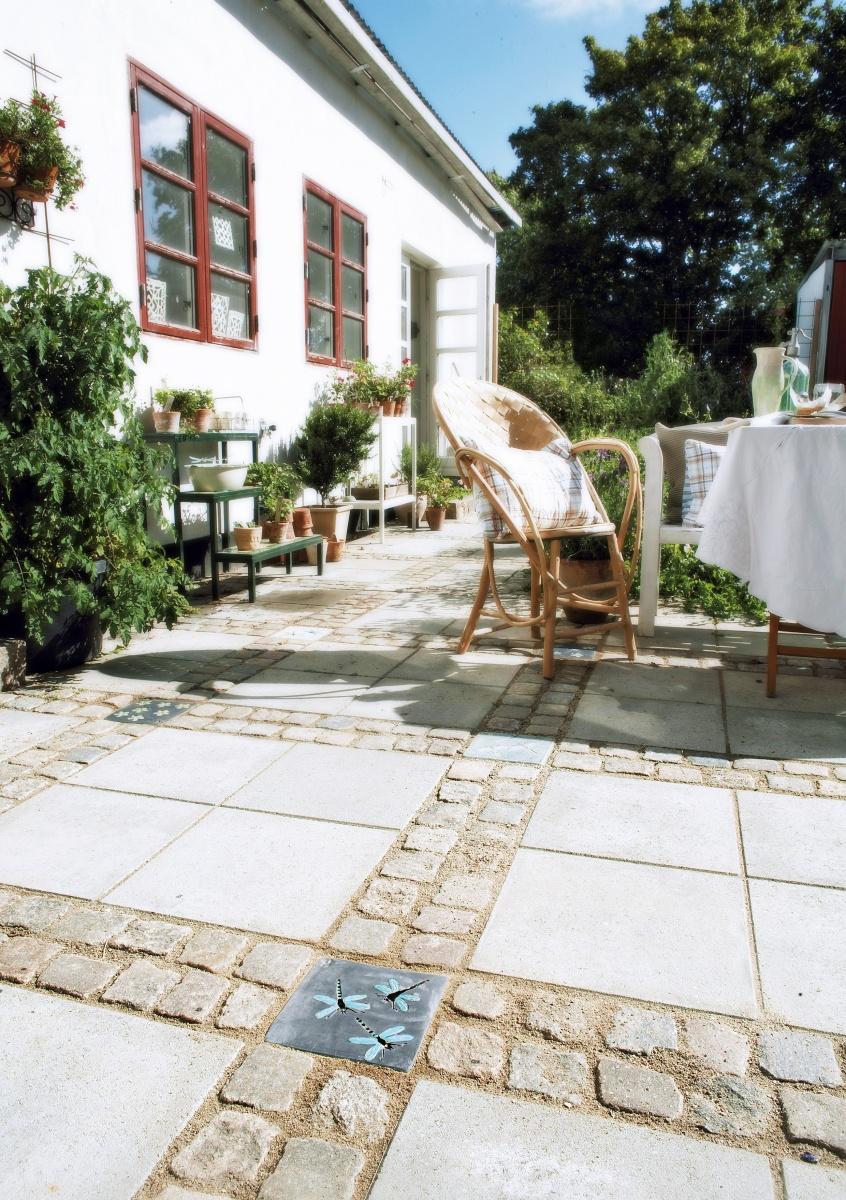 Udsmykningssten 20x20 i terrasse
